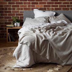 """This bed looks so good. We feel like jumping in. Regram of our Dandelion rug via"