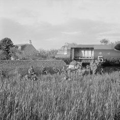 Glider troops of 6th Airborne Division beside their Horsa, which crashed through a stone wall on landing near La Haute Ecarde on the western end of DZ 'N' between Ranville and Sallenelles, 6th June 1944.