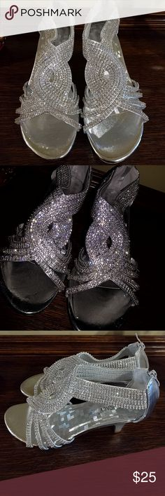 Beautiful rhinestone pumps The pictures do not do these shoes justice!! Delicacy brand formal heels with tons of sparkle and silver accent color. Never been worn! delicacy Shoes Heels