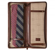 $199.00    Italian leather tie case. travel accessory is handcrafted in the USA with up to 130 steps, always preserving the beauty of the natural grain and texture. Keep your favorite ties stylishly well contained with this luxurious leather tie case designed in collaboration with Pierrepont Hicks. Featuring the celebrated tie company's new signature silk fabric on the interior, this zip around case has two elasticized leather straps on either side for holding up to four ties. The unique…