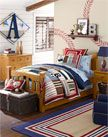 """SPORTY THEME BOYS BEDROOM from Pottery Barn Kids . . . """"The quilt squares and appliqués evoke baseball, soccer, letterman jackets and more, and above the bed an open shelf is the perfect place to display favorite sports memorabilia and championship trophies."""""""