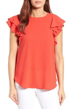 Bright colors and ruffles make this blouse perfect for any spring or summer ensemble