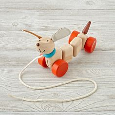 Shop Happy Puppy Wooden Pull Toy.  What makes this wooden dog pull toy so happy? It probably has something to do with his charming design and safe, water-based finish.