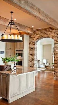 Love color scheme, walnut floors, white washed beams, cabinets and brick
