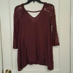 Long sleeved maroon blouse. Size small. Long sleeved lace. Its very flowy. Only worn once. I ordered it online and it doesn't fit!!! Charlotte Russe Tops Tees - Long Sleeve