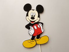 This 10 inch tall Mickey Mouse Die Cut with 12 white removable stick is a Great centerpiece choice for your Mickey Mouse Clubhouse Party theme! Or use him as a Cake Topper! The stick can be easily shortened by cutting with a sharp knife needed. ****THIS ITEM Ships in 1-3 Business Days**** If you want to purchase multiple items, contact me and Ill make you a Custom Listing and Combine shipping for you! More Party Supplies and Decor in my Shop: https://www.etsy.com/shop/Feis...