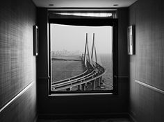 The Bandra-Worli Sea Link in Mumbai, India, is neatly framed by a hotel window in this National Geographic Photo of the Day.