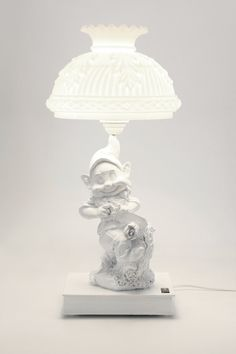 table lamp with book and gnome