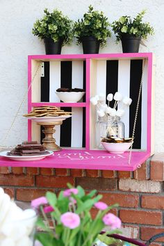 DIY Outdoor Serving Station - This could be used for some many things! Grilliing tools, drink station, Sunscreen and pool accessories, etc! Love the pink with black and white stripes! Perfect for outdoor parties and events - Click for tutorial - www.classyclutter.net #pink #building #DIY #stripes #DIHworkshop