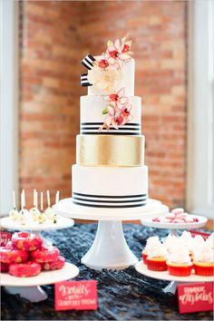 Gorgeous!  Gold and white black striped wedding cake.