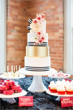 Gorgeous!  Gold and white black striped wedding cake.