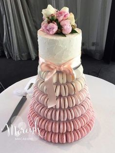 This beautiful tower is all wrapped up in a bow and flowers.
