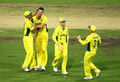 Josh Hazlewood of Australia celebrates with team mates after taking the wicket of Shikhar Dhawan of India during the 2015 Cricket World Cup Semi Final match between Australia and India at Sydney Cricket Ground on March 26, 2015 in Sydney, Australia.