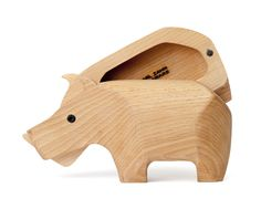Hinged wooden animals with secret storage by Areaware.