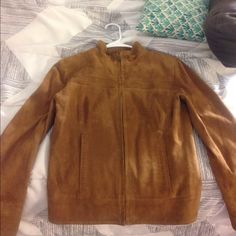 ColeHaan brown suede jacket. Fairly new. I got it from a thrift shop and never wore it because I could never find anything to wear with it. Cole Haan Jackets & Coats