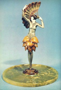 PHILIPPE: Fan Dancer, cold painted bronze and ivory, green onyx tray base.    (in Victor Arwas: Art Deco Sculpture. Chryselephantine Statuettes of the Twenties and Thirties. Academy Editions, London.)