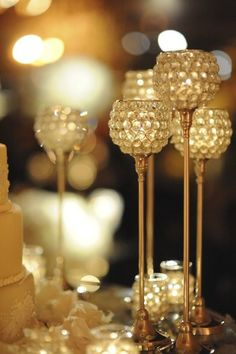 Tall candles make a romantic centerpiece, perfect for a wedding reception.