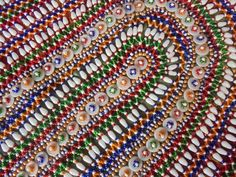 Rosie's Retreat Homestay, Udaipur. Rabari glass bead and shell work cushion cover for sale. rajpuralalli@gmail.com