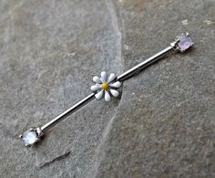 FREE SHIPPING ON ALL ADDITIONAL ITEMS! This industrial barbell is a standard 14 gauge hypoallergenic surgical steel.The bar is about 2 inches
