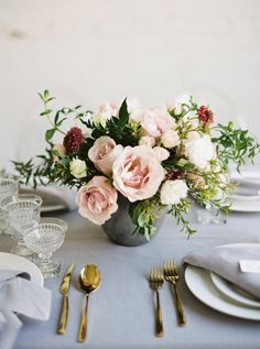 Rose centerpiece in a stone urn: http://www.stylemepretty.com/2017/03/27/modern-warehouse-wedding-ideas/ Photography: Kristine Herman - http://www.kristineherman.com/