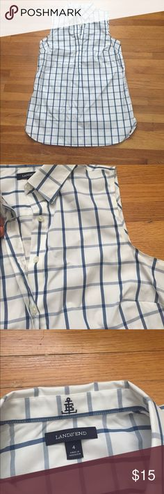 """🤓NWOT-Ladies Lands End sleeveless top🤓 NWOT - Lands End size 4 sleeveless top. Semi button down style. Buttons are hidden as pic shows.Blue and white. Laying flat 18"""" chest, 27"""" length and buttons go down 12"""". Super stylish and fun for summer/fall layered with a cardigan and worn w/jeans or leggings. Note the small slids at bottom :) Bought it and never had a chance to wear it so hoping it gets a new home through Posh. See burgundy red and white one also. Bundle and save!!! Lands' End Tops"""