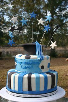 blue and black cap and tassel graduation cake