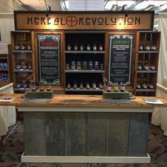 Herbal Revolution market & expo stand ~  Check out the beautiful new display. My partner Gus built the whole thing using reclaimed material from the farm and @gentlehex did the beautiful artwork on the boards. We're having a great time in Baltimore @natprodexpo #ExpoEast #NatrualProducts #Tradeshow
