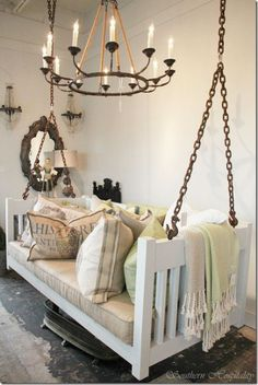 Hanging bed swing:) They did this as a bed but it would be good in a reading/study room or garden/reading room... Great idea!