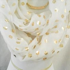 New 4 Leaf Clover Beautiful Infinity Scarf Beautiful scarf ivory with gold four leaf clovers throughout. Very lovely and elegant the gold necklace is available for sell as well. You get the best value for your money when you bundle. Accessories Scarves & Wraps