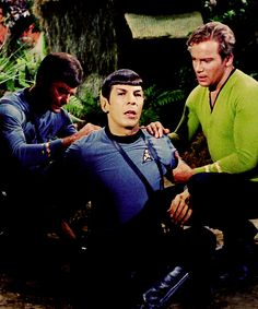 """McCoy tending to Spock's burns from the lightning strike. He diagnoses that they're not serious but are probably painful, to which Spock retorts, """"You have an unsurpassed talent for understatement, Doctor."""" From The Apple (Star Trek)"""