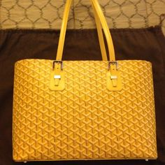 Goyard Okinawa tote Authentic Goyard Okinawa tote in yellow. Purchased at Goyard boutique in San Francisco in 2008. Comes with dust bag. In excellent condition, other than small nick and pen marks at the bottom. Price listed is its current original price. Open to offers. No trades. Goyard Bags Totes