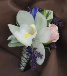 2 - Nice idea for the corsage pins or boutineres...like the neutrals with the purples. Like the different textures, but not necessarily the plain orchid.
