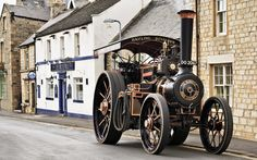 "A fine example of the ""Burrell"" Road Locomotive (traction engine) passing the Blue Bell Inn, Corbridge, Northumberland"