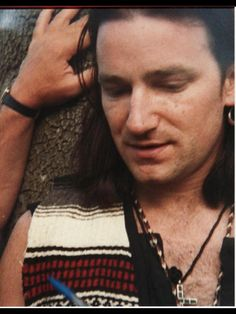 Bono-Joshua Tree era-hence the vest.