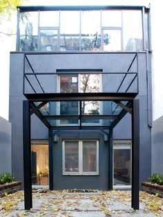 Blackened steel I-beams and structural steel harmonize with the clean lined architecture. Tempered glass provides unobstructed views through the landing.