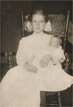 Young girl holds deceased infant.  Quakertown, PA, circa 1910.