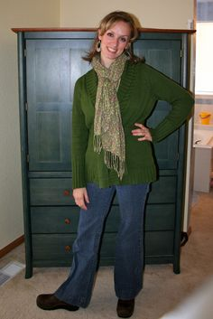 Green sweater, blue jeans and brown Dansko clogs