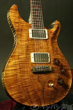 PRS guitar. Nice, I don't know what it is made of, but absolutely love the grain.   #guitars #music