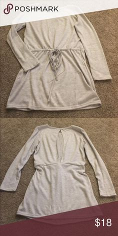 "Gray Sweater Tunic Back cutout, cinched waist with tie, comfy and very cute! New without tags (didn't come with any). I'm 5'4"" and this came to mid thigh when I tried on. Tops Tunics"