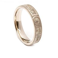 This wedding band was inspired by the Celtic Warrior Shield found on the Ardagh Chalice. It really is a piece of Irish history in one ring. This is a great choice for any woman who wants to share her Irish heritage with the world for the rest of her life. It is an intricate band that was actually handmade in Dublin, Ireland.  This beautiful ring is 4.4 to 4.5 millimeters in width. It is also made with a