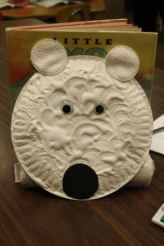 Oh My Gosh!  This was the cutest idea!  During our winter animals theme, I came across this craft at  http://easypreschoolcraft.blogspot.com/2012/01/polar-bear-puffy-paint-paper-plate.html.  You mix equal parts shaving cream and glue together with white paint.  The texture was awesome!  We used cosmetic rounds for the ears, googly eyes and a black circle for the nose.  We all fell in love with him!