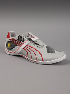 Puma® Ferrari Mens Future Cat Remix 2 SF Sneakers in White Rosso Corsa. You'll feel the thrill of the race when you wear these Future Cat mens sneakers from Puma's Ferrari line. Inspired by motorsports, these white mens Puma sneakers feature racing stripes across the sides and plenty of accents on the sole and heel, along with Puma's easy-to-recognize insignia.