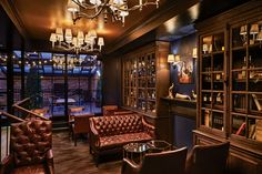 The interior of the Spirits Library in Columbia Room was designed by Streetsense to evoke the warmth and gracious invitation of a traditional club environment.
