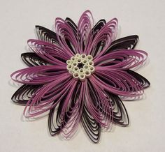 Handmade 3D Quilling or Quilled Flower Ornament Package Topper Card Embellishment Scrapbook Embellishment. $3.99, via Etsy.