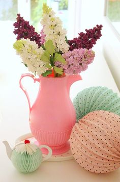 Spring flowers for a tea party. love the little tea cup decoration