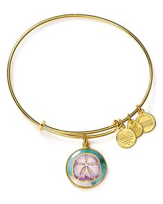 "Alex and Ani delivers a cute, colorful bangle sporting a whimsical sand dollar charm. Add it to your stack of bracelets for a sweet reminder of summer days. | Made in USA | 2.25"" diameter 