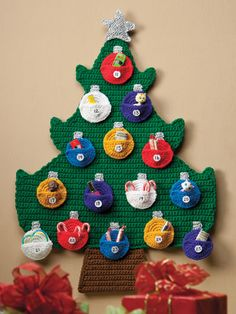 "e-PatternsCentral Advent Calendar Kids will love counting down the days until Christmas with this festive calendar that holds a special treat for each day. Size: 22 1/2"" x 32"". Made with medium (worsted) weight yarn, 18"" metallic ribbon and sizes F (3.75mm) and G (4mm) hooks. Skill Level: Beginner Category: Crochet"