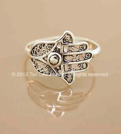 This ring features a protective hamsa hand. The hand has pretty filigree work and is so comfortable. It can be worn 24/7. All sterling silver. I