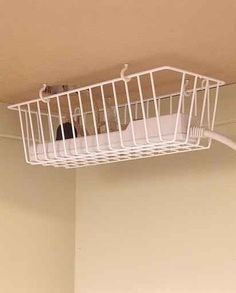 Hang a basket under your desk to keep cords off the floor (away from legs, vacuums, etc). It also looks better.