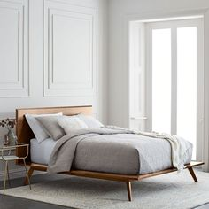 Mid-Century Platform Bed The clean lines of our Mid-Century Platform Bed get a new edge with playfully angled legs in a handsome walnut finish.
